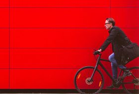 Man Cycling red wall