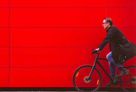 Man Cycling red wall