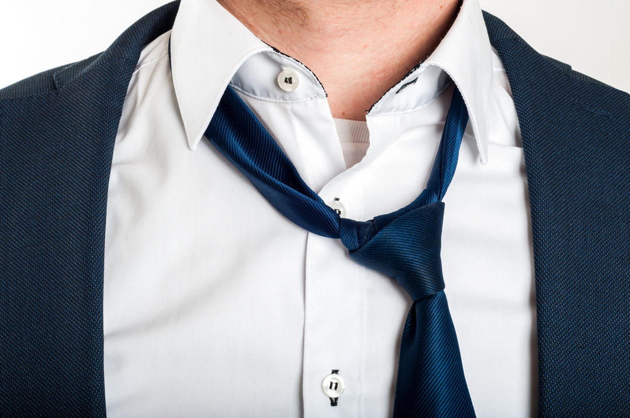 loose necktie on collar